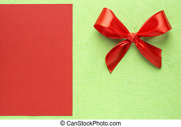 Red bow on green with red background