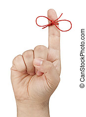 Red Bow on top of forefinger of front view male hand for reminding isolated
