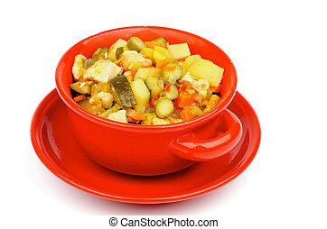 Red Bowl of Vegetables and Chicken Ragout with Zucchini, Potato, Carrot, Bell Pepper, Tomatoes, Cabbage and Leek isolated on white background