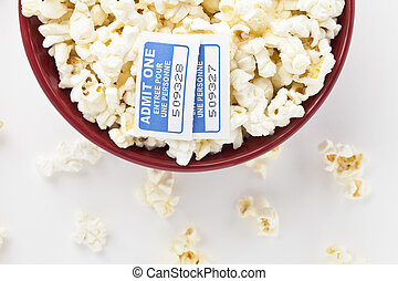 red bowl with popcorn and tickets