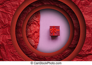 Red box with a gift on a pink background.