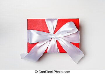 Red box with a gift on a white background
