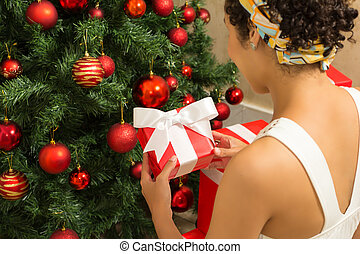 Red box with bow being held by Young woman.