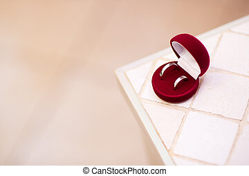 wedding rings on the edge of a table