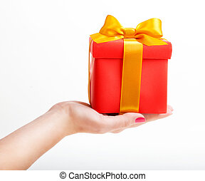 Red box with yellow ribbon in hand