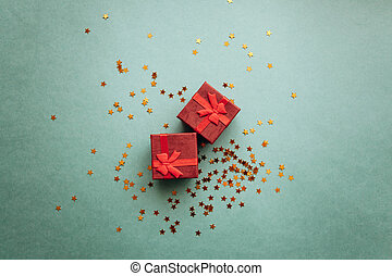 Red boxes with gifts on a green background