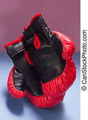 red Boxing gloves on a pink background,