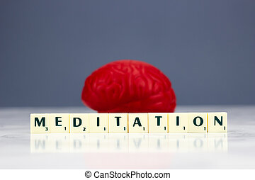 Red brain with meditation sign