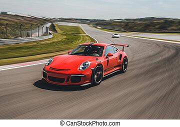 Red brand sport car high speed drive