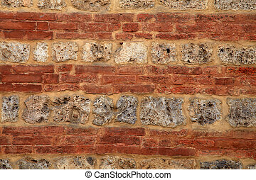 Red brick and stone medieval weathered wall textured background