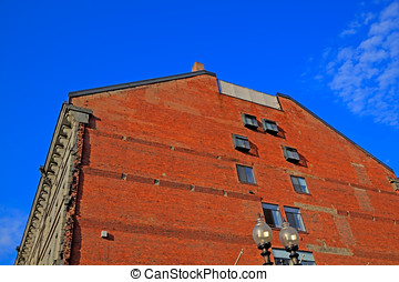 Red brick building wall. - Red brick building wall with...