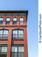 REd Brick Building with Green Trim