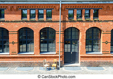brick building - red brick building with large windows in...