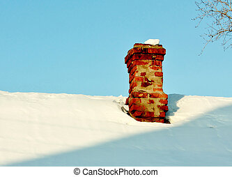 chimney - red brick chimney of farmhouse in winter
