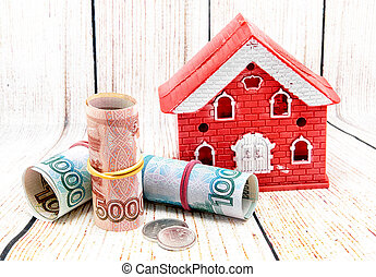 Red brick house and Russian money. Buying suburban housing