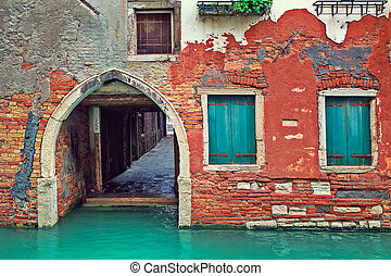Red brick house and small canal in Venice, Italy.