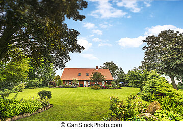 Red brick house in a beautiful garden