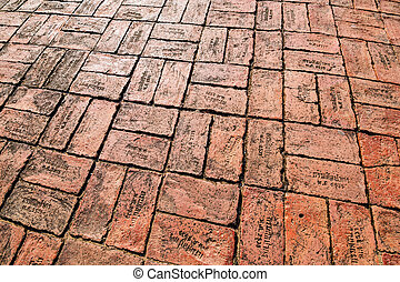 Red brick paving on a sidewalk at Ayutthaya, world heritage, Tha