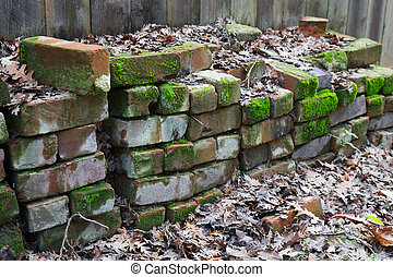 Red brick piles fence