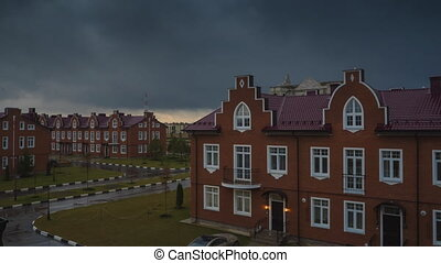 Red brick townhouses in bad weather. Time lapse video