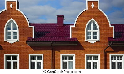 Red brick townhouses rooftops time lapse clip