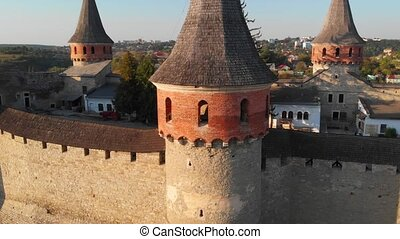 Aerial drone perspective of a turret and battlements of Kamianets Podilskyi Castle in Ukraine in closeup.
