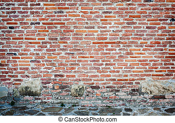 Red brick wall background with stone basement