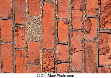 Red brick wall. - Fragment of old squared red brick wall.