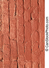 red brick wall gives a harmonic pattern in the sun