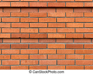 Red brick wall in rows, tiers. With small cracks. Masonry, ledge, 2 lines of recess, deepening