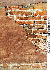 red brick wall in sunshine - portrait format