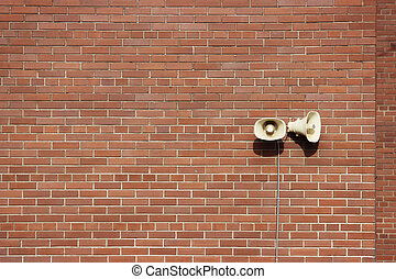 Red brick wall of a residential building and two...