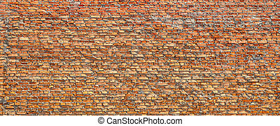 Red brick wall partially destroyed by rain. Texture.