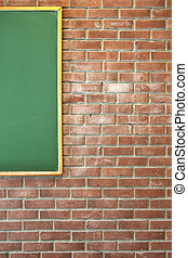 Red brick wall with a green blackboard