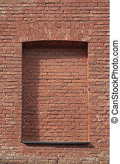 Red brick wall with closed windows. Architecture