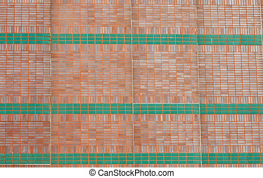 Red Brick Wall with Green Stripes