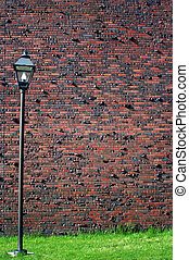 Red brick wall with lamp