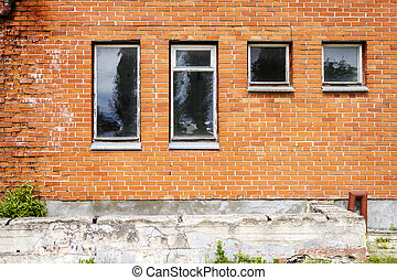 Red brick wall with some windows