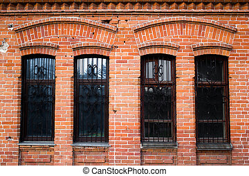 Red brick wall with Windows