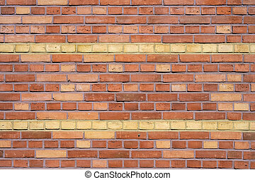 Red brick wall with yellow stripes