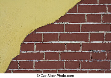 red brick wall with yellow stucco