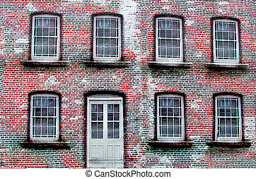 Red brick with white door and symmetrical windows
