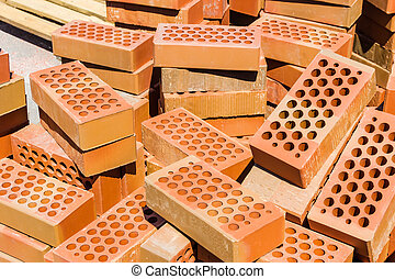 Red Clay Bricks With Holes In Them Stacked Stock Photographs