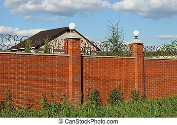 red bricks wall of fence with white lanterns