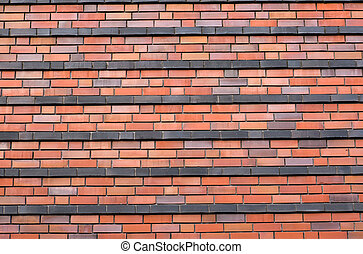 Red brickwall with black stripes