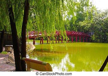 Bridge connecting the edge of Hoan Kiem Lake in the Den Ngoc Son Pagoda on the island