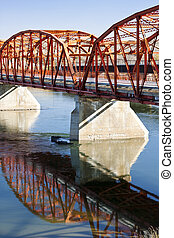 Red Bridge over the Calm River - Old red bridge over the ...