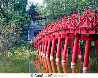 Red Bridge over the Hoan Kiem Lake, leading to the Buddhist temple on Jade Island, Hanoi, Vietnam