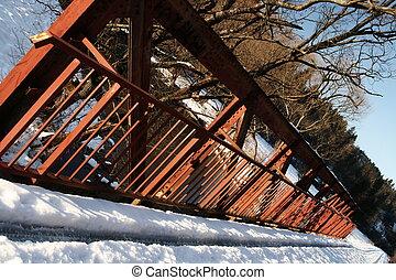 Snowy red bridge