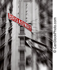 red broadway sign, black and white photo, zoom blur